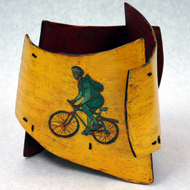 wood vessel with bike rider image